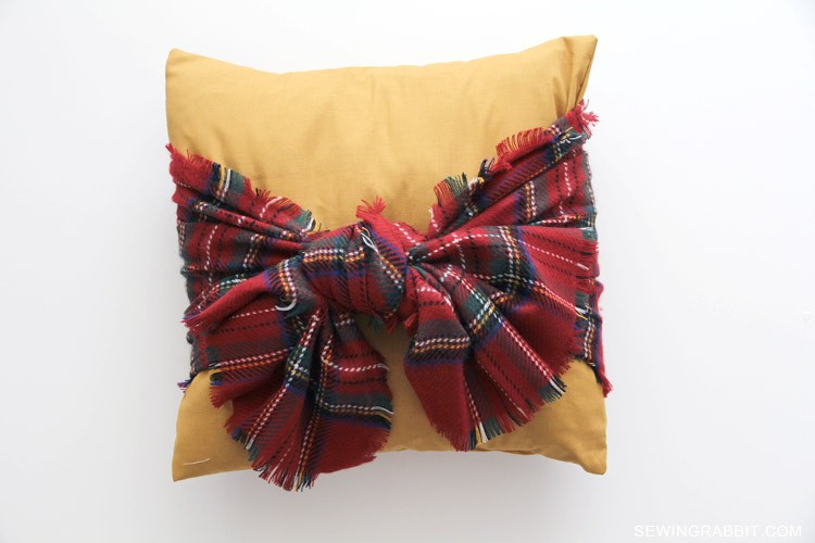 Tie a Scarf around a Basic Pillow for an instant Autumn / Winter update!