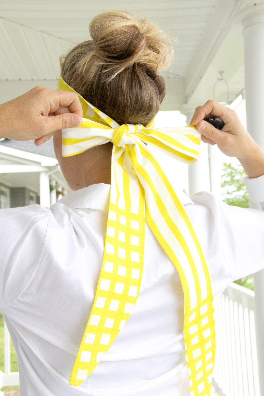 tie the fabric along the nape of your neck to secure the visor in place