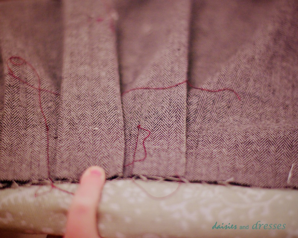 Stitch in the ditch from the front side of sleeve.