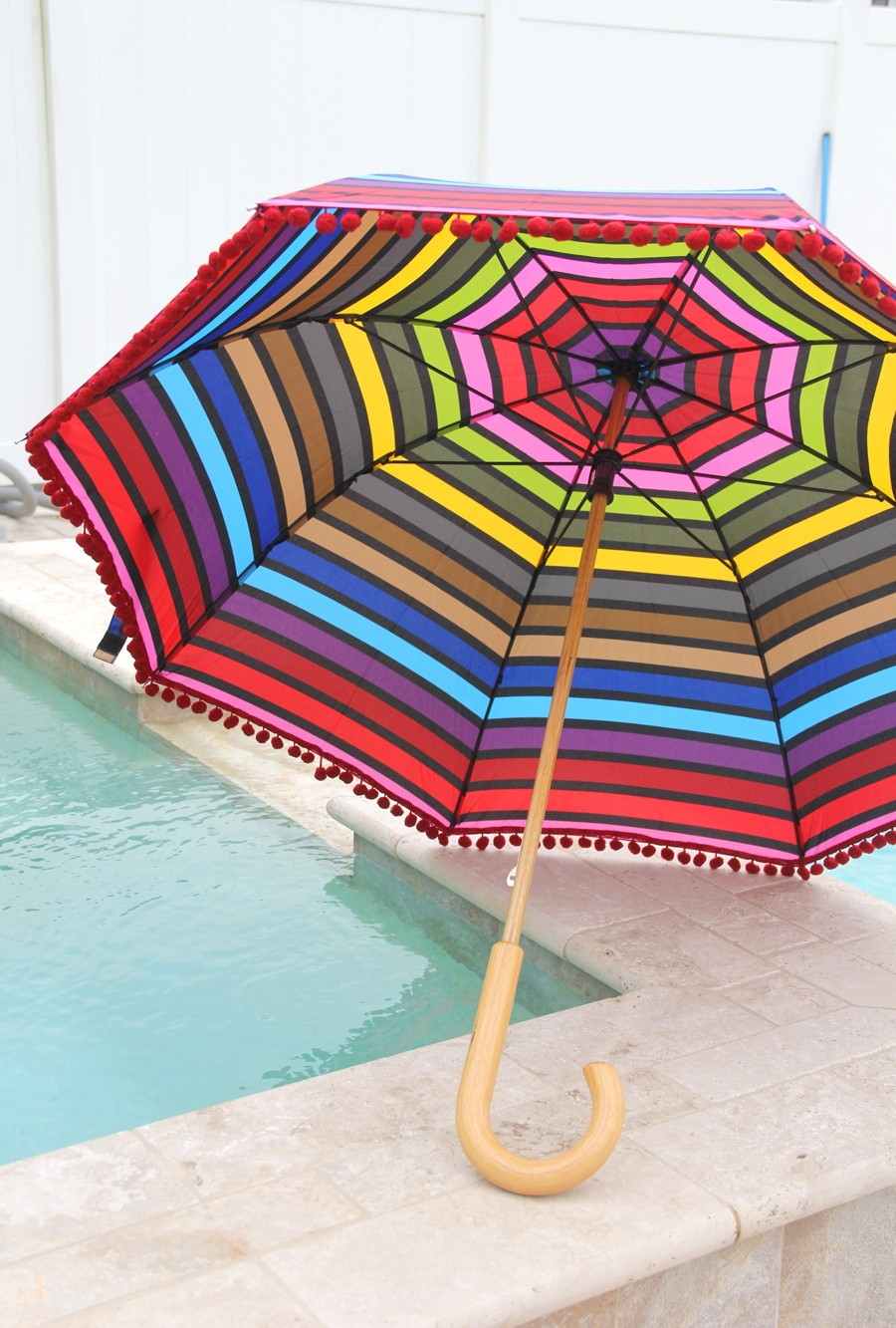 add pom poms to your umbrella for a fun, decorative trim!