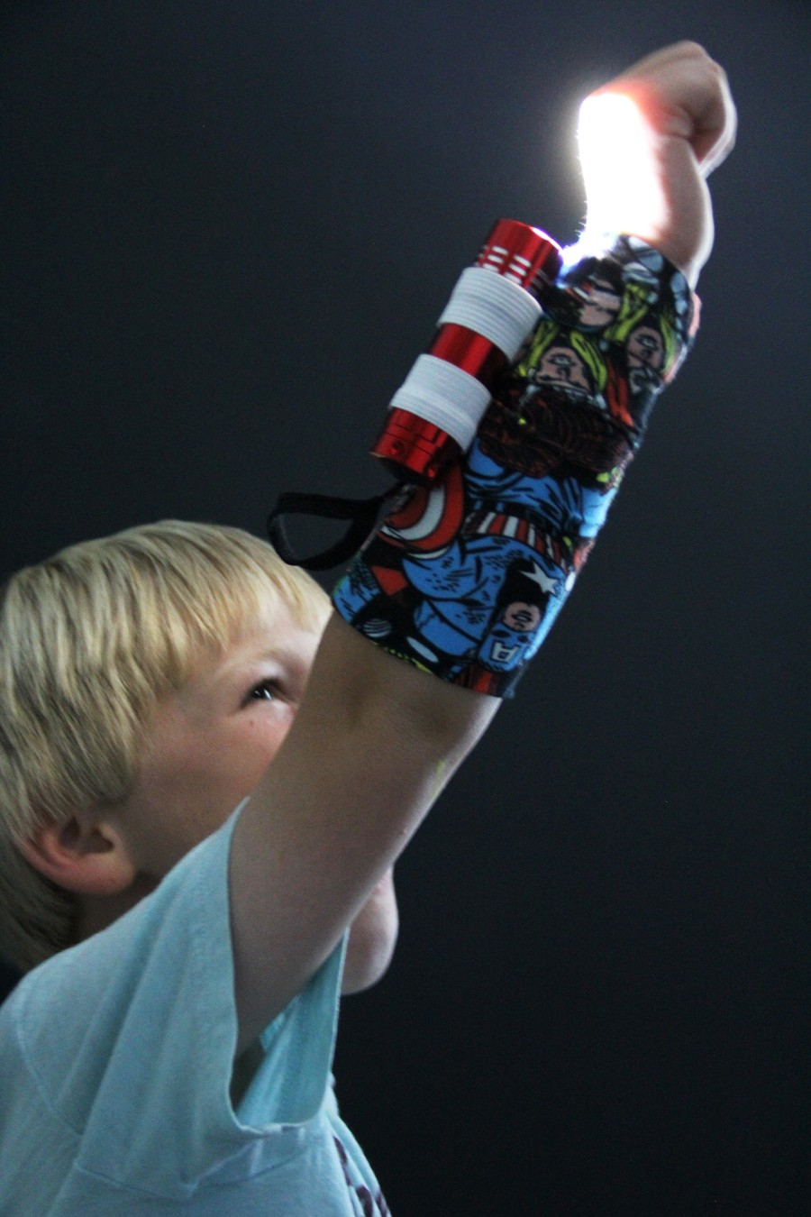 perfect for camping, fun summer nights, the fourth of july, Halloween, or just superhero fun!!! Flashlight armband DIY